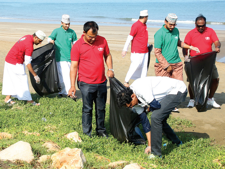 Bahwan IT Marks 49th National Day with a Clean Beach Campaign